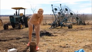 Naked chopping wood- andrea sky