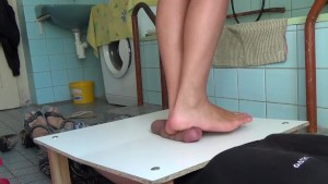 Pressed cock full weight under the beautiful bare feet