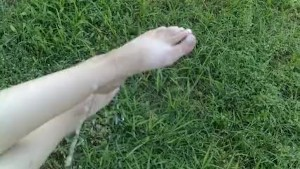 Pissing on girlfriends feet outdoors