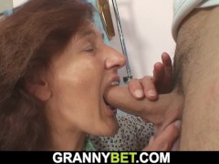 Clothed granny loves sucking and fucking his cock