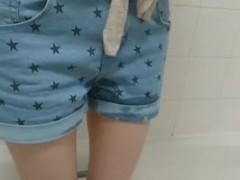 little girl wets her denim shorts