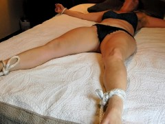 Masked MILF gets tied up and tickled