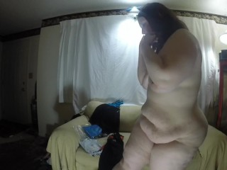 thick redhead tries on lingerie and shows her fat ass to the camera