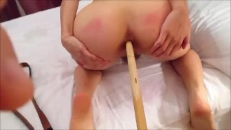 Abusing her Ass with a Stick until She Cums