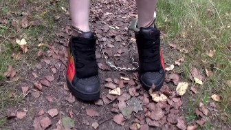 Walking cuffed and gagged outdoors