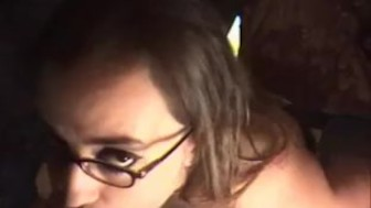 Sexy brunette in glasses knows how to suck a cock