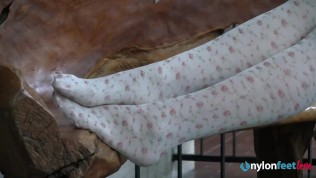 Blonde shows off her feet in stockings